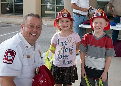Firemen with two kids