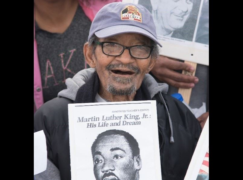 Photo featuring Senior Citizen Volunteer Award Winner Harvey E. Miller at 2018 MLK March. Photo By D