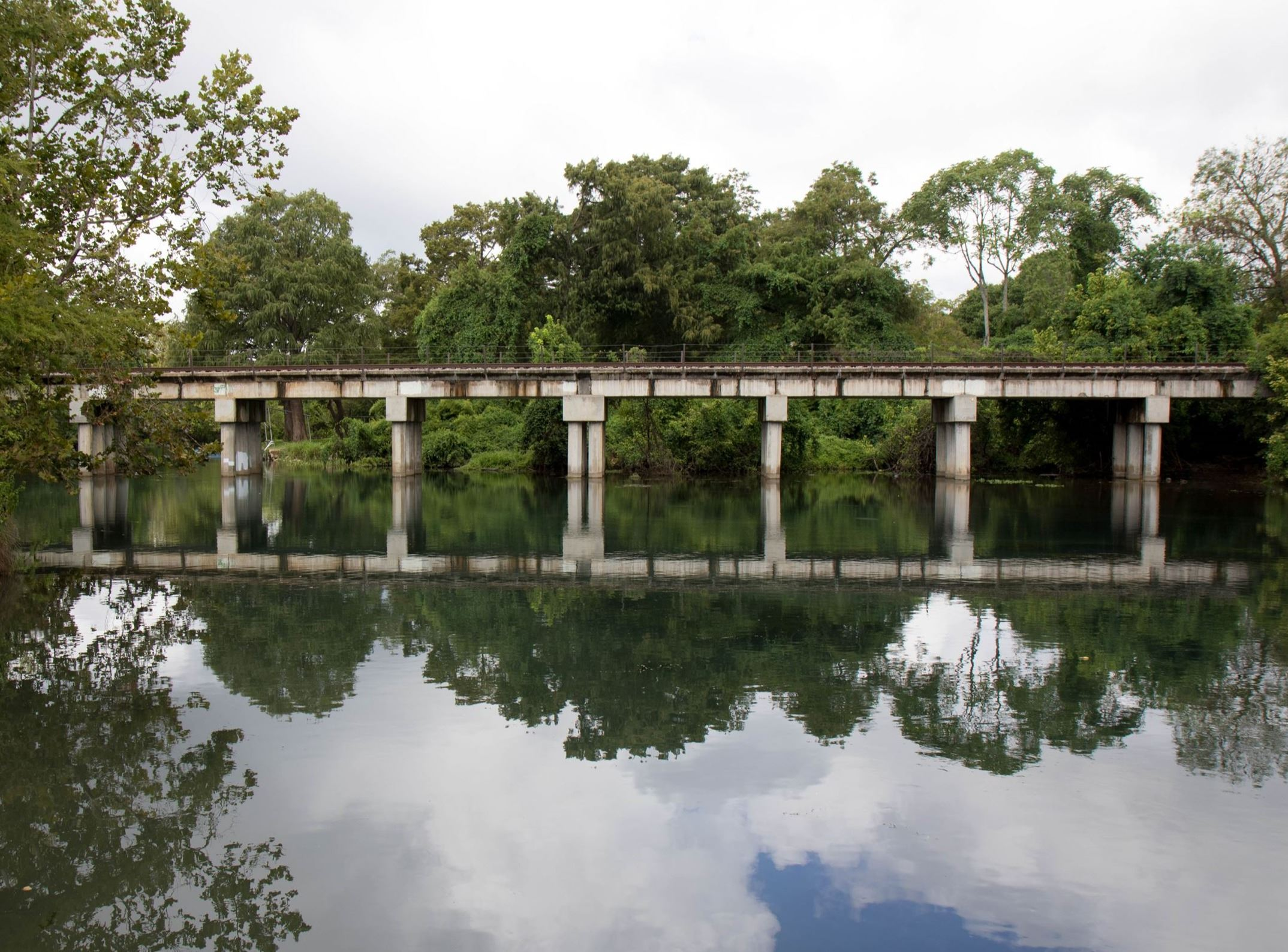 Photo of train crossing over San Marcos River in Rio Vista Park