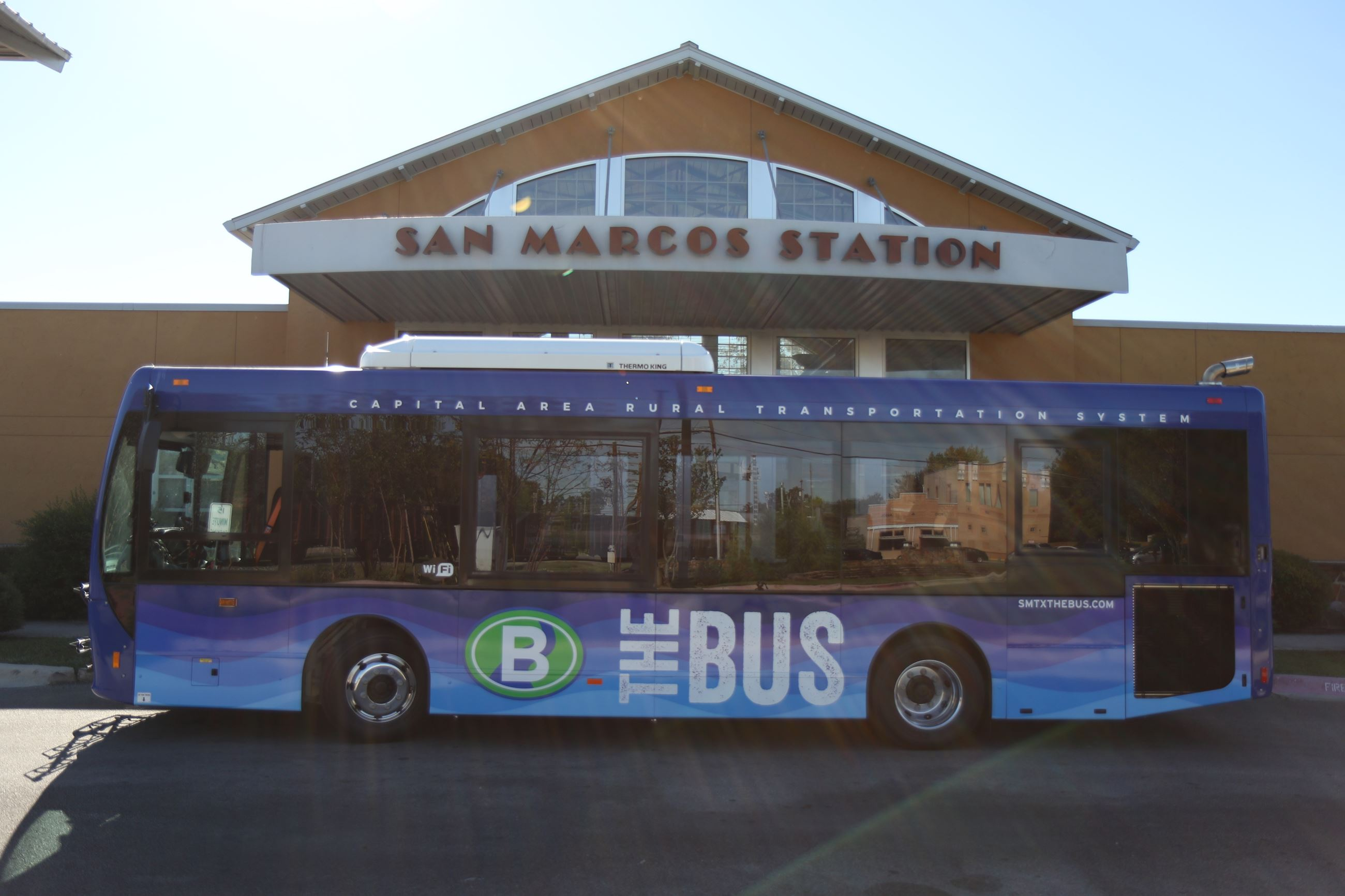 San Marcos &#34The Bus&#34 vehicle in front of bus station