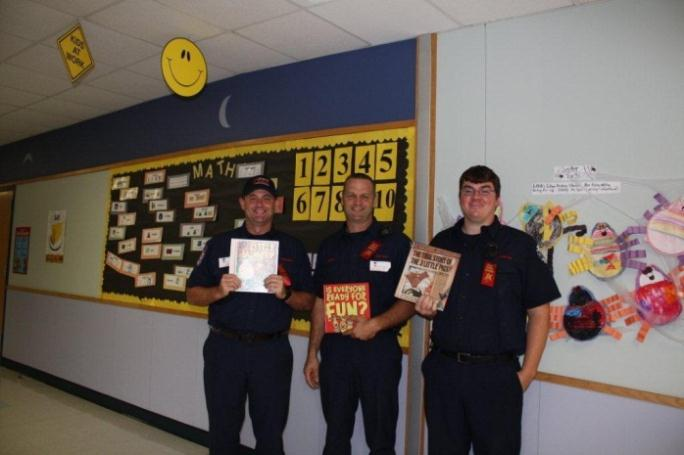 Firefighters Holding Books