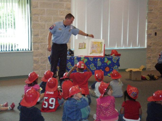 Firefighter Reading to Kids
